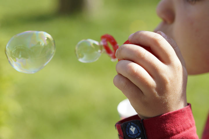 Demonstrate How To Blow a Bubble To Your Kid